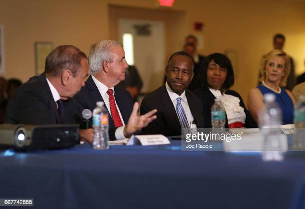Jorge Perez CEO Related Urban Group Carlos Gimenez mayor of MiamiDade sit with US Housing and Urban Development Secretary Ben Carson during a visit...