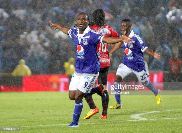 Jorge Perlaza of Millonarios celebrates a goal against Cucuta during a match between Millonarios and Cucuta as part of the Liga Postobon 2013 at...