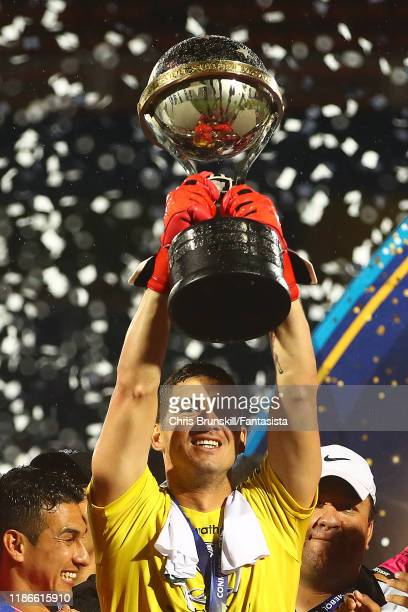 Jorge Pinos of Independiente lifts the trophy following the final of Copa CONMEBOL Sudamericana 2019 between Colon and Independiente del Valle at...