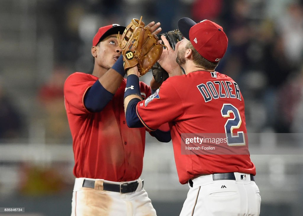 Jorge Polanco #11 and Brian Dozier #2 of the Minnesota Twins celebrate winning against the Arizona Diamondbacks after the game on August 18, 2017 at Target Field in Minneapolis, Minnesota. The Twins defeated the Diamondbacks 10-3.