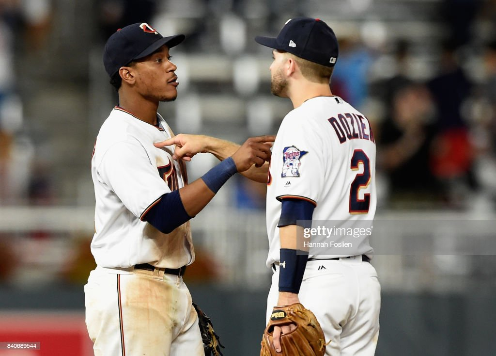 Jorge Polanco #11 and Brian Dozier #2 of the Minnesota Twins celebrate winning against the Chicago White Sox after the game on August 29, 2017 at Target Field in Minneapolis, Minnesota. The Twins defeated the White Sox 6-4.