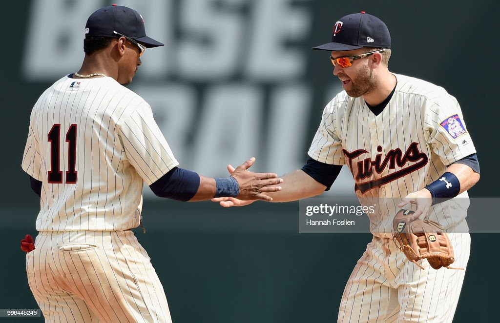 Jorge Polanco #11 and Brian Dozier #2 of the Minnesota Twins celebrate defeating the Kansas City Royals after the game on July 11, 2018 at Target Field in Minneapolis, Minnesota. The Twins defeated the Royals 8-5.