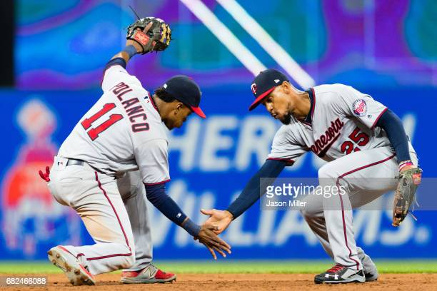 Jorge Polanco and Byron Buxton of the Minnesota Twins celebrate after defeating the Cleveland Indians at Progressive Field on May 12 2017 in...