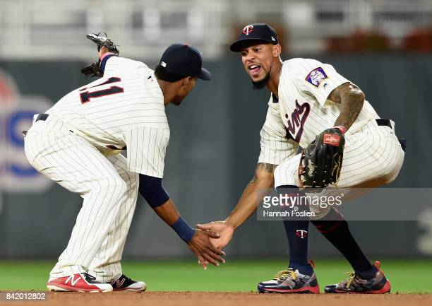 Jorge Polanco and Byron Buxton of the Minnesota Twins celebrate winning against the Kansas City Royals after the game on September 2 2017 at Target...