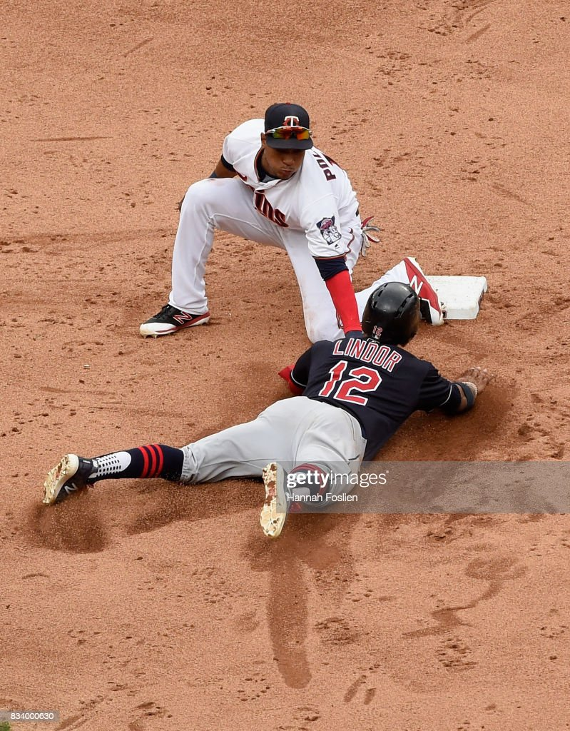 Jorge Polanco #11 of the Minnesota Twins catches Francisco Lindor #12 of the Cleveland Indians stealing second base during the sixth inning in game one of a doubleheader on August 17, 2017 at Target Field in Minneapolis, Minnesota. The Indians defeated the Twins 9-3.