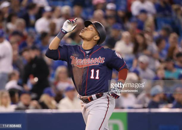 Jorge Polanco of the Minnesota Twins celebrates after hitting a solo home run in the seventh inning during MLB game action against the Toronto Blue...