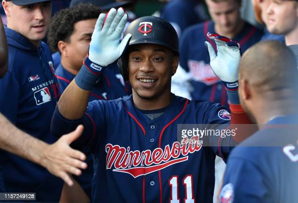Jorge Polanco of the Minnesota Twins celebrates his home run with teammates in the first inning against the Kansas City Royals at Kauffman Stadium on...