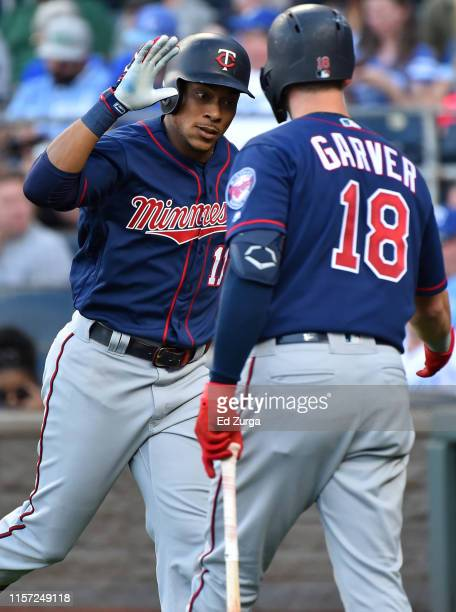 Jorge Polanco of the Minnesota Twins celebrates his home run with Mitch Garver in the first inning aKansas City Royals at Kauffman Stadium on June 20...