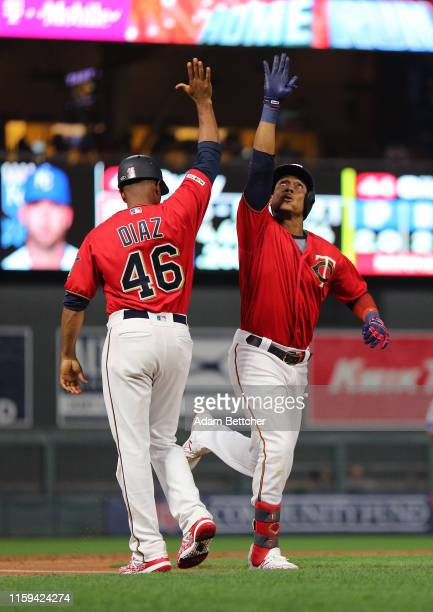 Jorge Polanco of the Minnesota Twins celebrates his three run homer with Tony Diaz of the Minnesota Twins in the second inning against the Kansas...