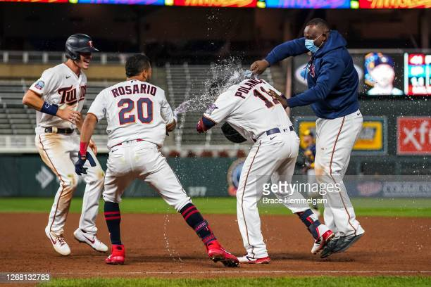 Jorge Polanco of the Minnesota Twins celebrates his walkoff hit with Miguel Sano Eddie Rosario and Max Kepler against the Milwaukee Brewers on August...