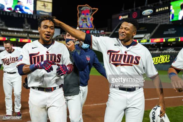 Jorge Polanco of the Minnesota Twins celebrates with Jorge Alcala against the Milwaukee Brewers on August 18 2020 at Target Field in Minneapolis...