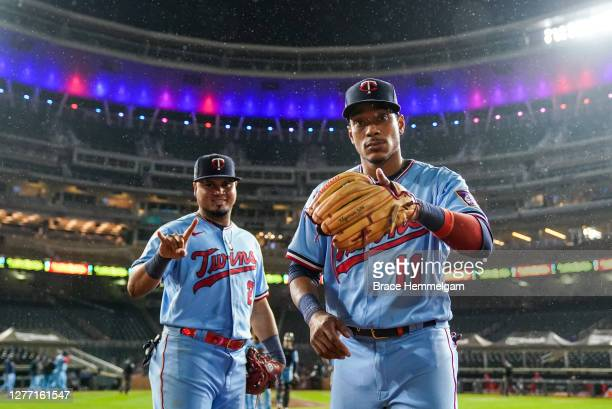 Jorge Polanco of the Minnesota Twins celebrates with Luis Arraez against the Cincinnati Reds on September 26 2020 at Target Field in Minneapolis...