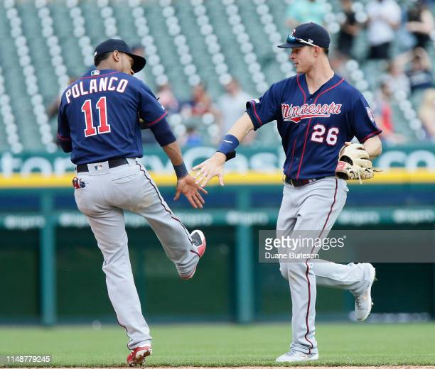 Jorge Polanco of the Minnesota Twins celebrates with Max Kepler of the Minnesota Twins after a 12-2 win over the Detroit Tigers at Comerica Park on...