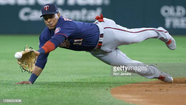 Jorge Polanco of the Minnesota Twins dives for a run scoring single off the bat of Nick Solak of the Texas Rangers during the first inning at Globe...