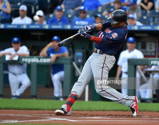 Jorge Polanco of the Minnesota Twins hits a home run in the first inning against the Kansas City Royals at Kauffman Stadium on June 20 2019 in Kansas...