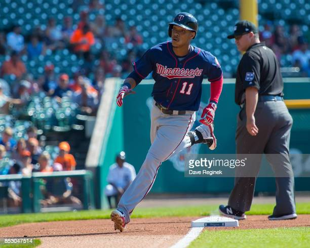 Jorge Polanco of the Minnesota Twins hits a solo home run in the first inning against the Detroit Tigers during a MLB game at Comerica Park on...