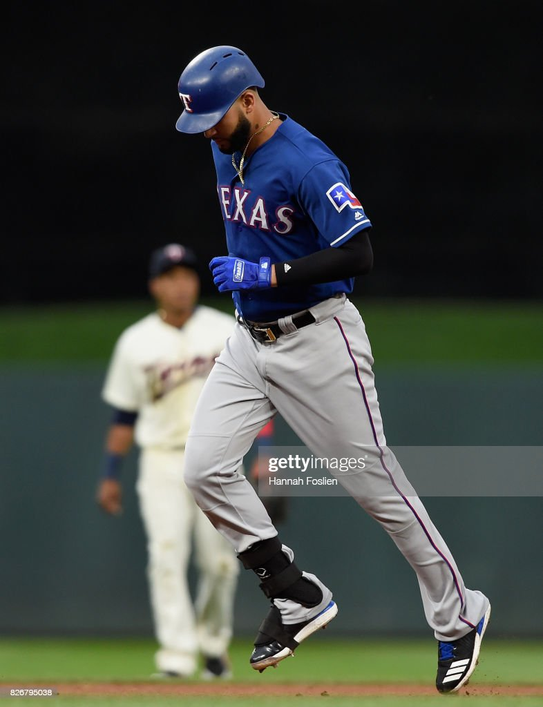 Jorge Polanco #11 of the Minnesota Twins looks on as Nomar Mazara #30 of the Texas Rangers rounds the bases after hitting a two-run home run during the first inning of the game on August 5, 2017 at Target Field in Minneapolis, Minnesota. The Rangers defeated the Twins 4-1.