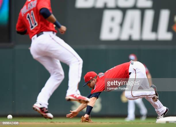Jorge Polanco of the Minnesota Twins looks on as teammate Brian Dozier is unable to field the ball hit by Mallex Smith of the Tampa Bay Rays during...