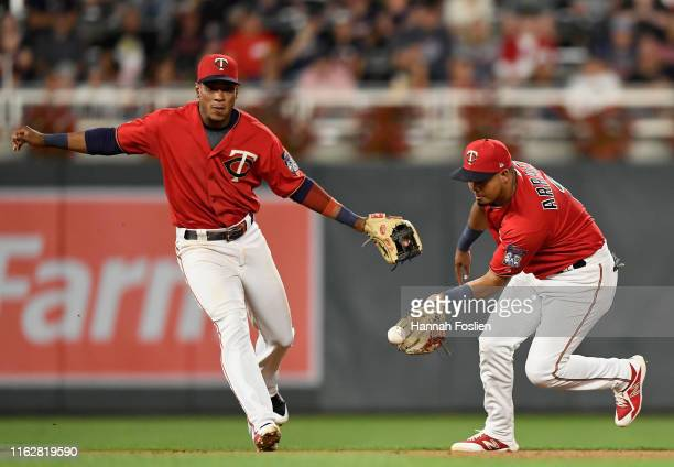 Jorge Polanco of the Minnesota Twins looks on as teammate Luis Arraez fields the ball hit by Eloy Jimenez of the Chicago White Sox during the sixth...