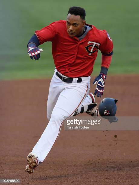 Jorge Polanco of the Minnesota Twins looses his helmet as he runs the base path between second and third base after hitting an RBI triple against the...