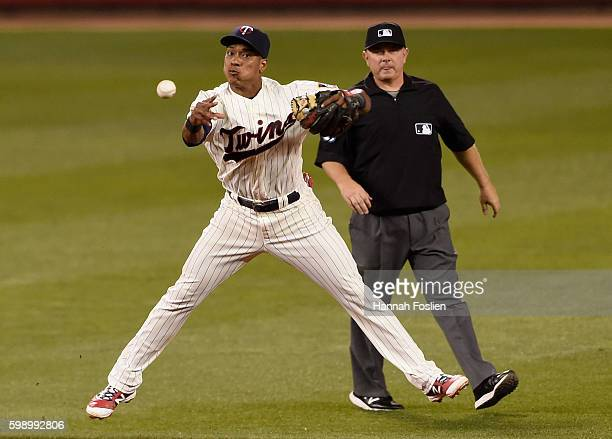 Jorge Polanco of the Minnesota Twins makes a play at shortstop to get out Carlos Sanchez of the Chicago White Sox at first base as umpire Greg Gibson...