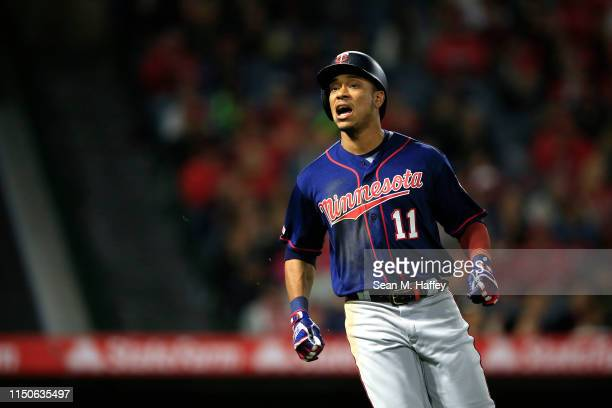 Jorge Polanco of the Minnesota Twins reacts to flying out during the fifth inning of a game against the Los Angeles Angels of Anaheimat Angel Stadium...