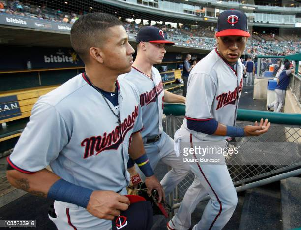 Jorge Polanco of the Minnesota Twins right talks with Ehire Adrianza of the Minnesota Twins left as they head to the field with Max Kepler of the...