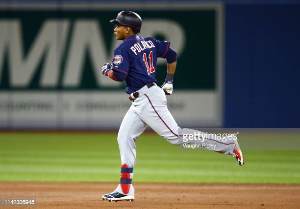 Jorge Polanco of the Minnesota Twins runs the bases after hitting a tworun home run in the second inning during a MLB game against the Toronto Blue...