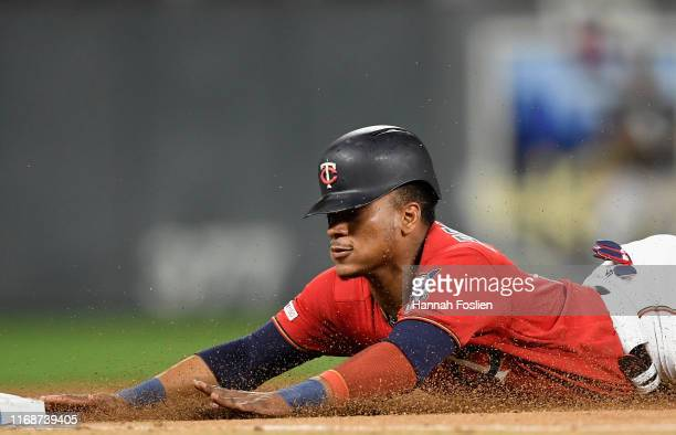 Jorge Polanco of the Minnesota Twins slides safely into third base against the Chicago White Sox during the fifth inning of the game at Target Field...