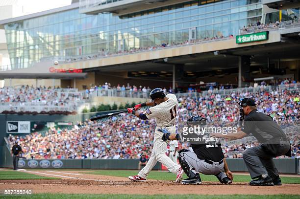 Jorge Polanco of the Minnesota Twins takes an at bat as Dioner Navarro of the Chicago White Sox catches during the game on July 30 2016 at Target...