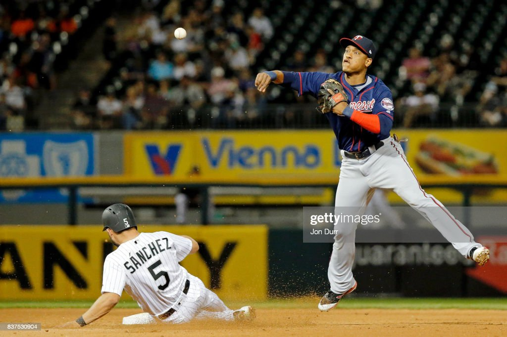 Jorge Polanco #11 of the Minnesota Twins throws to first base after forcing out Yolmer Sanchez #5 of the Chicago White Sox to complete a double play to end the sixth inning at Guaranteed Rate Field on August 22, 2017 in Chicago, Illinois.
