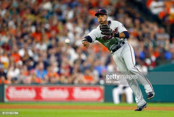 Jorge Polanco of the Minnesota Twins throws to first base to retire Evan Gattis of the Houston Astros in the fourth inning at Minute Maid Park on...