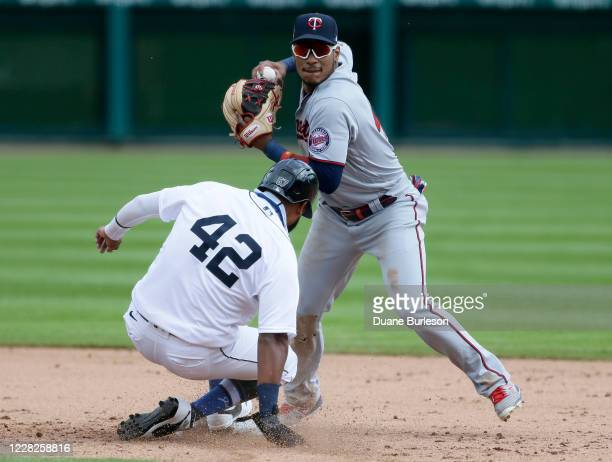 Jorge Polanco of the Minnesota Twins turns the ball after getting a force out on Jorge Bonifacio of the Detroit Tigers at second base during the...