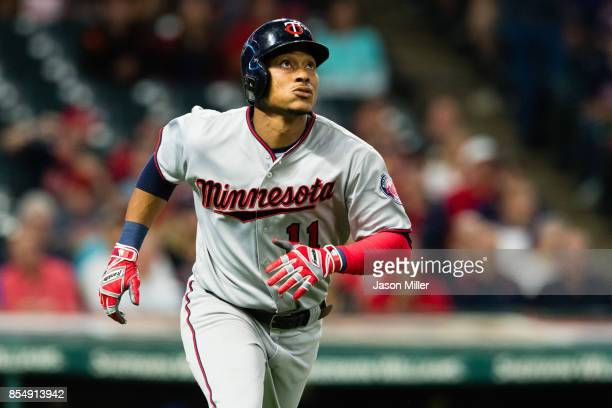 Jorge Polanco of the Minnesota Twins watches a two run home run clear the right field fence during the ninth inning against the Cleveland Indians at...