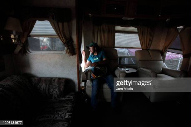 Jorge Ponce looking out of his circus trailer on May 20 2020 in Queretaro Mexico As nonessential activities are not permitted during stage three of...