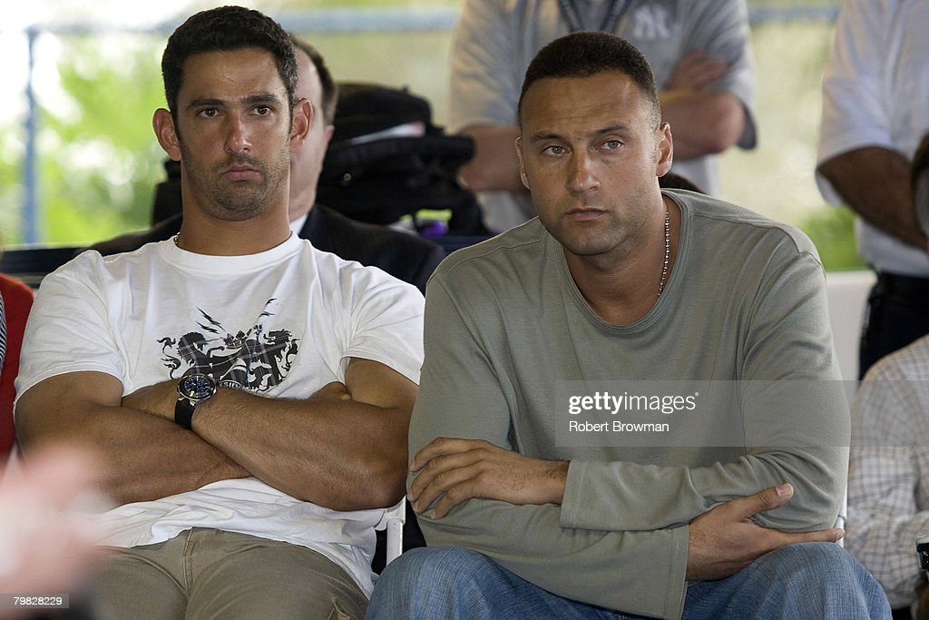 Jorge Posada and Derek Jeter watch as teammate Andy Pettitte of the New York Yankees speaks to the media during his press conference to discuss his HGH (Human Growth Hormone) use on February 18, 2008 at Legends Field in Tampa, Florida.