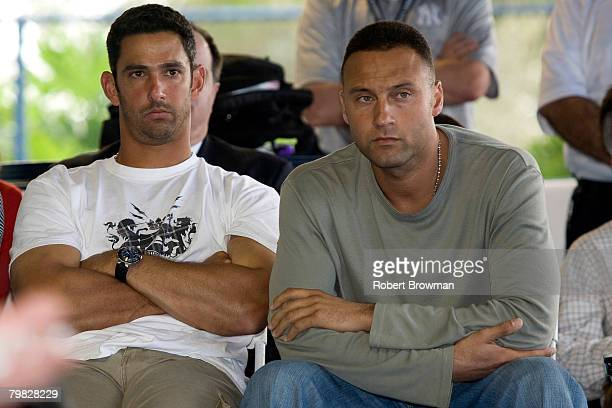 Jorge Posada and Derek Jeter watch as teammate Andy Pettitte of the New York Yankees speaks to the media during his press conference to discuss his...