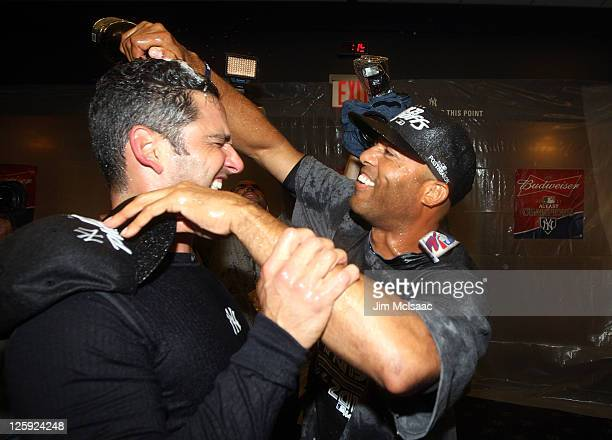 Jorge Posada and Mariano Rivera of the New York Yankees celebrate after clinching the American League East division against the Tampa Bay Rays on...