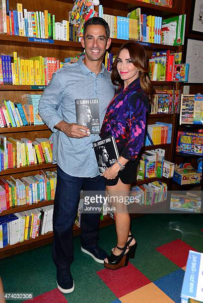 Jorge Posada and wife Laura Posada pose after greeting fans and signs copies of his book 'The Journey Home My Life In Pinstripes' at Books and Books...