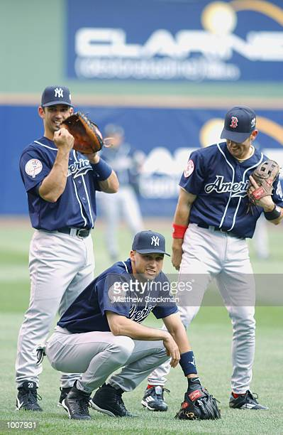 Jorge Posada Derek Jeter of of the New York Yankees and Nomar Garciaparra of the Boston Red Sox chat in the outfield during batting practice for the...