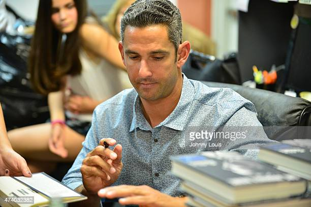 Jorge Posada greets fans and signs copies of his book 'The Journey Home My Life In Pinstripes' at Books and Books on May 19 2015 in Coral Gables...