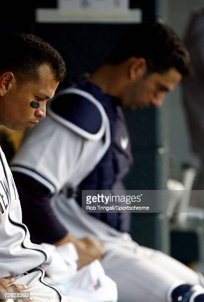Jorge Posada of the New York Yankees and Alex Rodriguez sit dejected in the dugout in a game against the Detroit Tigers during Game Four of the 2006...