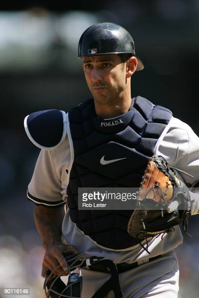 Jorge Posada of the New York Yankees catches during the game against the Seattle Mariners at Safeco Field on August 16 2009 in Seattle Washington The...