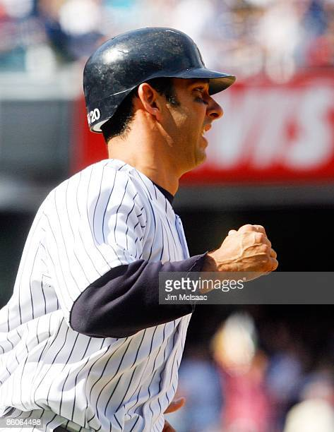 Jorge Posada of the New York Yankees celebrates after hitting a solo home run in the fifth inning against the Cleveland Indians during opening day at...