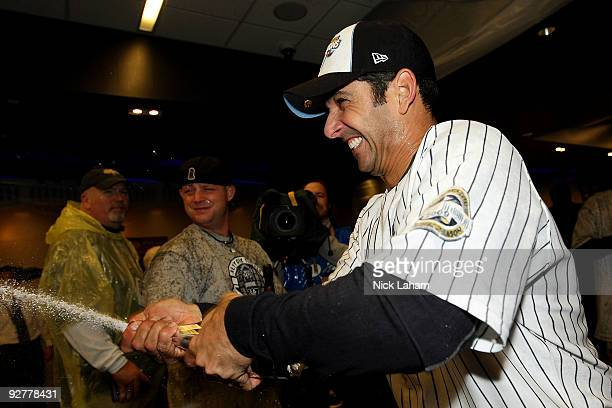 Jorge Posada of the New York Yankees celebrates in the locker room after their 73 win against the Philadelphia Phillies in Game Six of the 2009 MLB...
