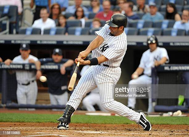Jorge Posada of the New York Yankees connects for an RBI single in the bottom of the first inning against the Cleveland Indians on June 10 2011 at...