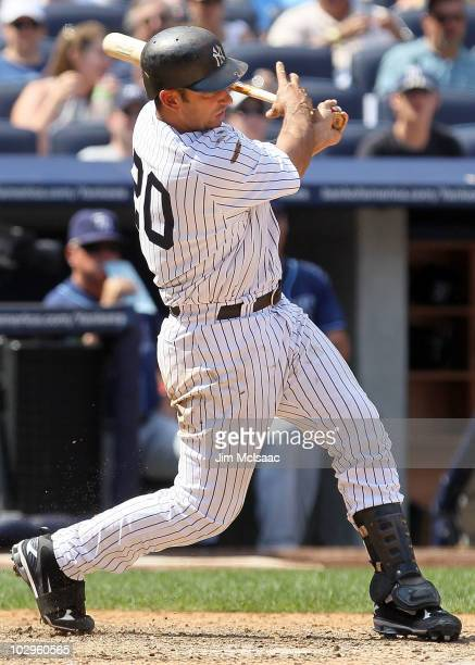 Jorge Posada of the New York Yankees follows through on a two run double in the fifth inning against the Tampa Bay Rays on July 18 2010 at Yankee...