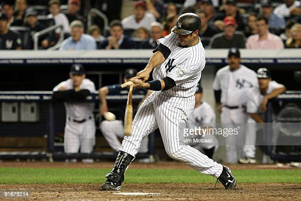 Jorge Posada of the New York Yankees hits a broken bat single in the tenth inning against the Minnesota Twins in Game Two of the ALDS during the 2009...