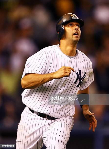 Jorge Posada of the New York Yankees hits a two run home run off of Curt Schilling of the Boston Red Sox in the fifth inning on May 10 2006 at Yankee...