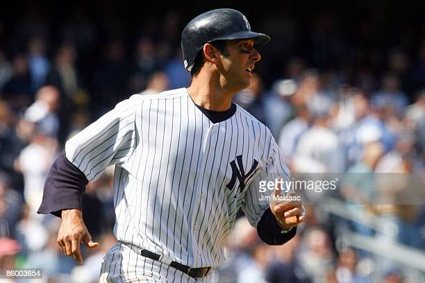 Jorge Posada of the New York Yankees rounds the bases after hitting a solo home run in the fifth inning against the Cleveland Indians during opening...